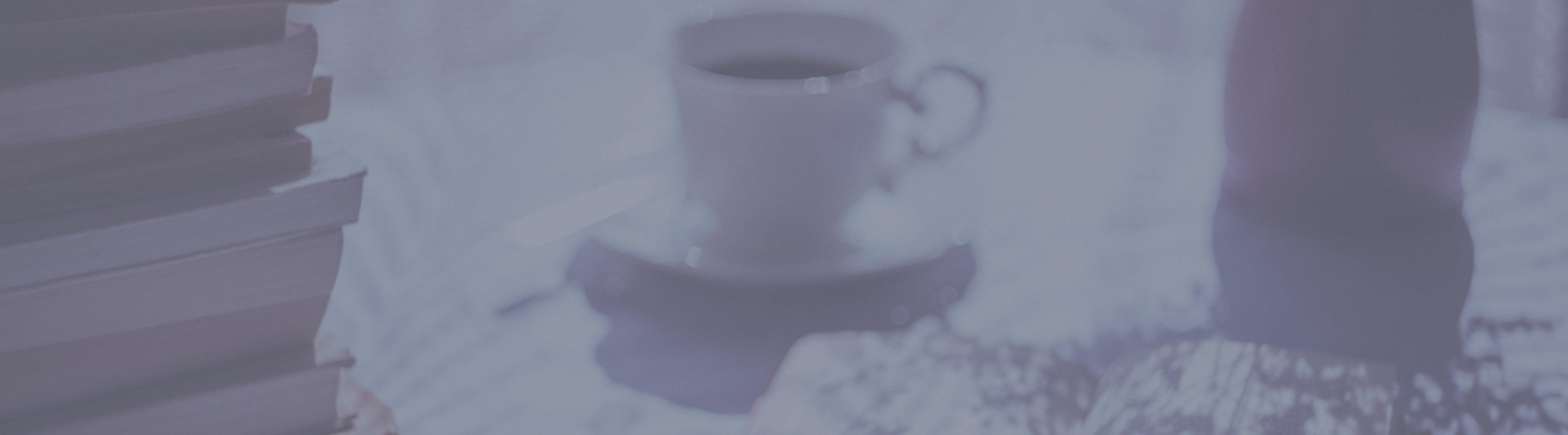 Books and coffee mug on table
